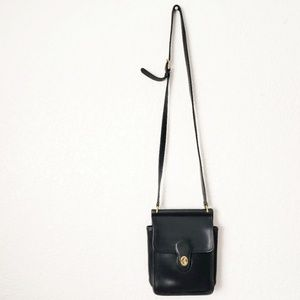 Coach: Vintage Black Leather Crossbody Saddle Bag